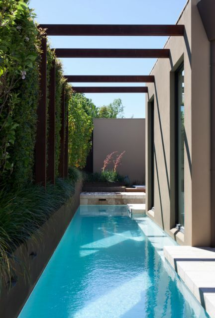 A Very Small Backyard Accomodates Only A Cool Narrow Pool For Relaxing Backyard Pool Designs Small Pool Design Small Backyard Pools