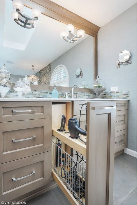 The Chic Technique: Clever bathroom in-cabinet torage idea for hairdryer, curling iron, etc.
