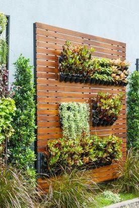 Vertikaler Garten Als Bepflanzte Sichtschutzwand Bild 12 Vertikale Gartenmauer Gartengestaltung Vertikaler Krautergarten