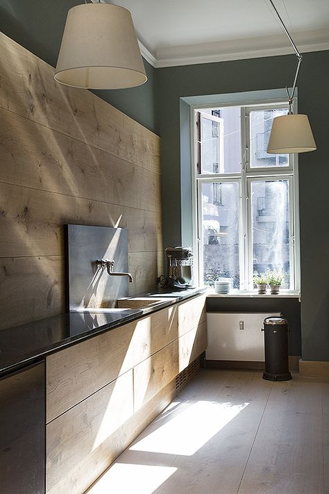 Contemporary wooden kitchen with green walls. I'm noticing green becoming a really trend in kitchens this year.