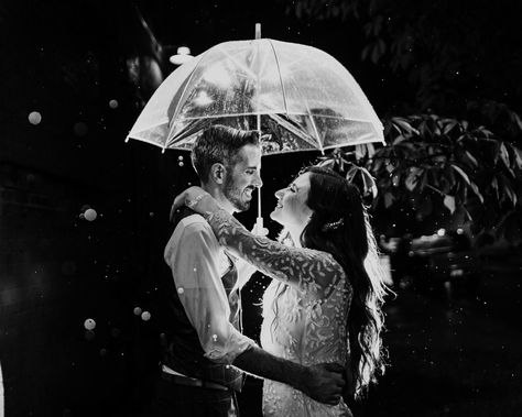 Romantic photo of bride and groom under umbrella in the rain at The Joinery Chicago wedding