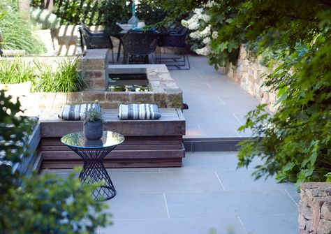 Courtyard Garden with separate areas for relaxation & dining. Lovely use of landscaping materials & clever use of space. Nicely integrated water feature too.
