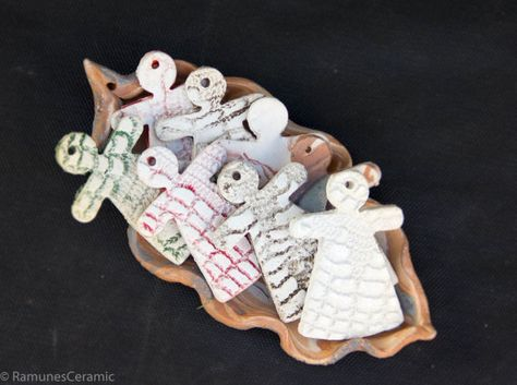 It's handmade ANGEL shape gift, Christmas tree decoration. It is made from white clay. Ornaments are with lace imprint in both sides. You can use them as xmas or Holiday decor, as Unique Stocking stuffers fillers ideas. Decoration is not under glaze. Every item will unique.    Decorations is made from a slab of clay and hand stamped with a favorite design. No two will be exactly alike since each item is individually formed, therefore, each piece will be unique. Due to computer monitors and…
