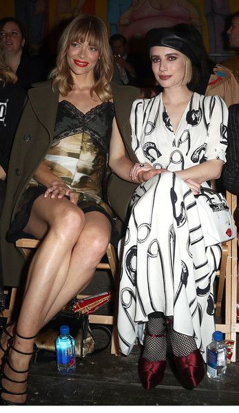 Actresses Jaime King (L) and Emma Roberts attend Moschino Spring/Summer 19 Menswear and Women's Resort Collection.