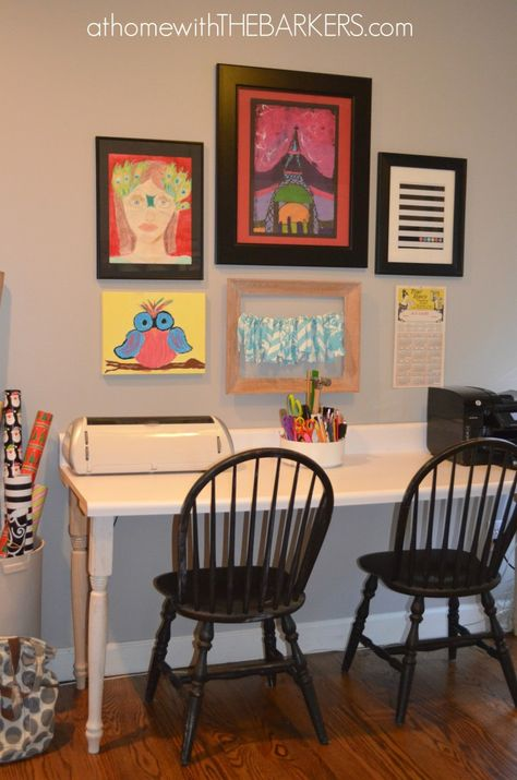 Love the idea of placing pics above a work station for the family.