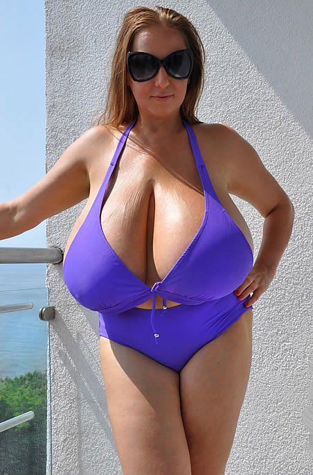 Gigantic boobs in purple top