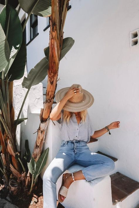 street style, style inspo, high waisted jeans, light wash leans, slides, straw hat, beachy blouse
