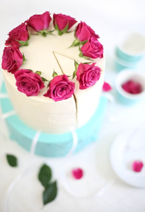 I just like how they arranged the roses on this cake. Raspberry-Champagne Layer Cake with Victorian Cake Pulls