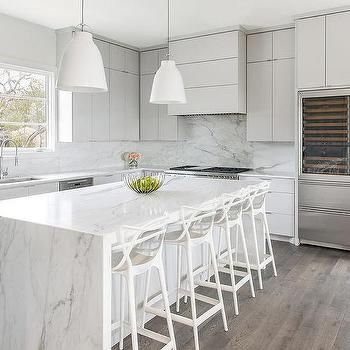 White And Gray Quartz Waterfall Countertop On Light Gray Island Waterfall Countertop Countertop Inspiration White Shaker Cabinets