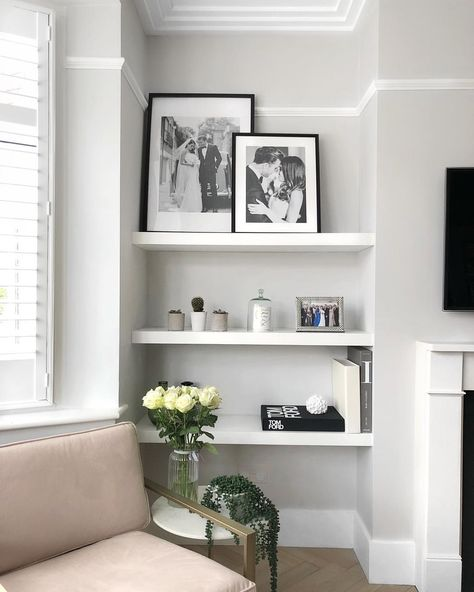 I'm thinking of *maybe* painting this room really dark grey/navy...what do you guys think?!