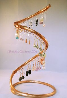 Bracelet Display Stand Ideas Can you guess what this DIY jewelry display stand is made from 17
