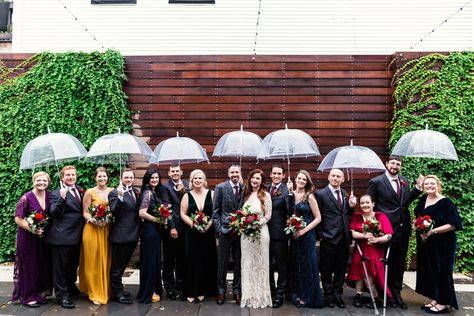 Fashionable fall wedding party in jewel tones with umbrellas at The Joinery Chicago