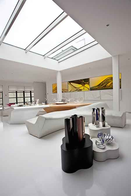 Zaha Hadid's designs are seldom considered comfortable or even functional, but in her generously size apartment where a number of her most avant-garde designs are grouped together, her creations appear less impractical. From iconic pieces such as her Iceberg bench, Morine sofa, and Stalagmite-Stalagtite table to her vases and bowls, here the unusual forms come together seamlessly,