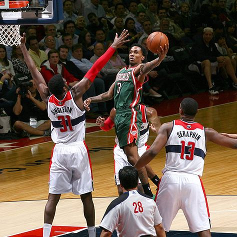 Brandon Jennings scores two of his team-high 19 points to help the