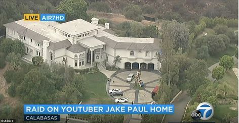 Aerial footage of the raid, taken by ABC7, showed law enforcement officers walking out of ...