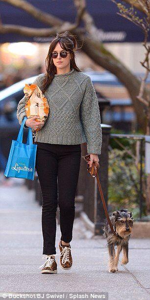 Girl's best friend: Dakota Johnson dresses down to take her delighted pup Zeppelin for a walk in New York City