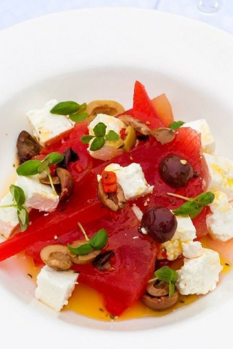 The best watermelon and feta salad is served at the Sopwell House in St. Albans, outside of London. Served with fresh basil and mint chiffonade, it's absolutely delicious. #salad #watermelon #feta #summersalad #recipe