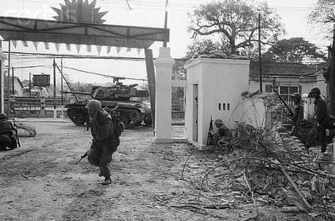 05 Feb 1968, Hue, Vietnam --- 2/5/1968-Hue, South Vietnam: A U.S. Marine ducks for cover while radioing information during fierce fighting here. The Marines stormed in to enemy held houses, throwing canisters of tear gas and non poisonous nausea gas, but enemy forces donned gas masks and held onto most of the city. U.S. officers reported that the stiff resistance by the enemy meant that the battle for hue could drag on for days, perhaps even weeks. --- Image by © Bettmann/CORBI...