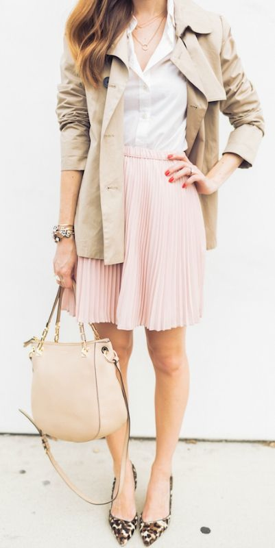 This pink skirt paired with a white skirt and patterned pumps gives the ideal…