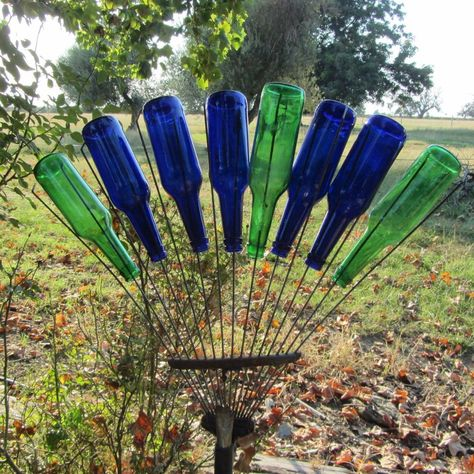playing with bottles bottle Garden art Playing With Bottles Wine Bottle Garden, Wine Bottle Trees, Wine Bottle Art, Wine Bottle Crafts, Wine Bottles, Blue Bottle, Glass Bottle, Perfume Bottles, Garden Crafts
