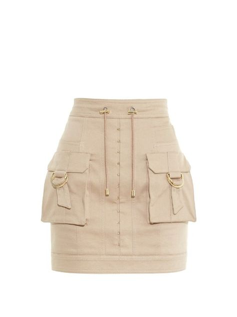 Everything about this beige stretch-cotton mini skirt is classic Balmain. It's detailed with the label's recurring cargo accents – note the flapped pockets, drawstring waist, and slick hardware. Accentuate the streamlined fit with a figure-hugging top.