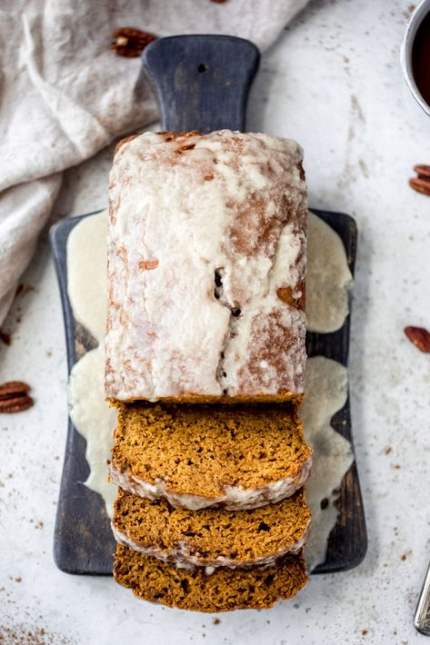 The best healthy pumpkin bread made with an entire can of pumpkin puree! This cozy, healthy pumpkin bread recipe is loaded with pumpkin spices and naturally sweetened with pure maple syrup. It's perfectly moist, topped with the most addictive maple glaze and can easily be made into pumpkin muffins! #pumpkinbread #quickbread #breakfast #snack #fallrecipe #brunch #pumpkinrecipe