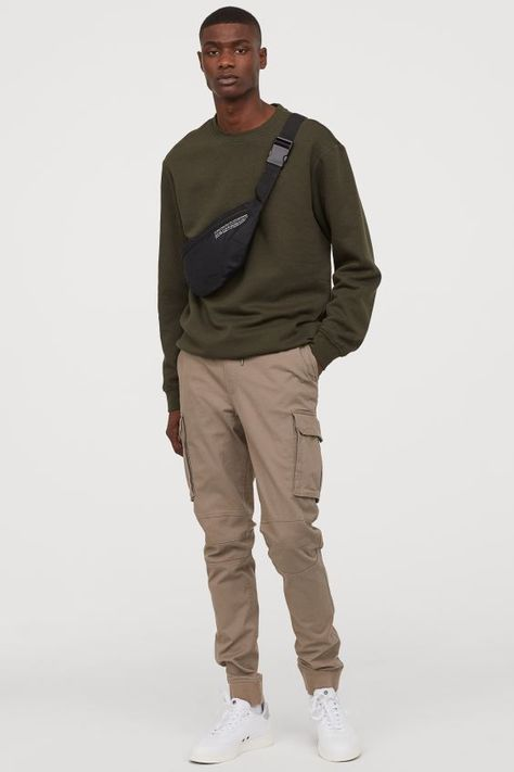 Joggers in cotton twill. Elasticized drawstring waistband, side pockets, and back and leg pockets with flap and concealed snap fasteners. Tapered legs with Black Men Street Fashion, Korean Street Fashion, Mens Fashion, Outfits For Teens, Casual Outfits, Men Casual, Oversized Tshirt Outfit, Cargo Pants Outfit Men, Baggy Clothes