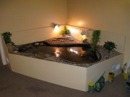 Indoor, decorative turtle habitat. This is awesome....like an island retreat for your turtles.