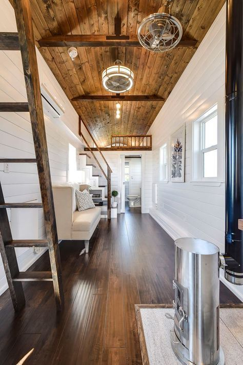The White Tongue And Groove Wall Panelling And Dark Stained Wood Flooring And Ceiling Give The Interior A Tiny House Company Modern Tiny House Tiny House Towns