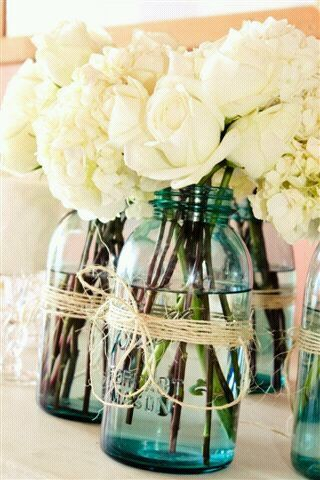 This is from a friend's wedding. Her colors were a teal blue and white. It was a beach wedding so this definitely fit the requirements. A smiple Mason jar and twine. :)