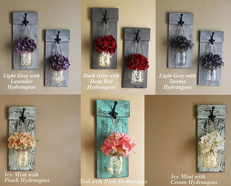 Customize to fit your décor, rustic mason jar lighted wall sconces. Bring a little rustic beauty into your home with these beautiful hanging mason jar sconces. These would look great next to your family photos, displayed next to doorways or even to just decorate that one bare wall