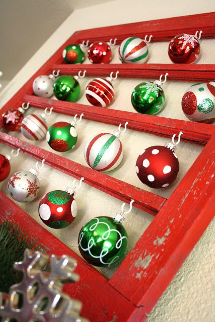 Old window frame, some hooks, Christmas ornaments Maybe an upscale version to show some of mom's prized ornaments.