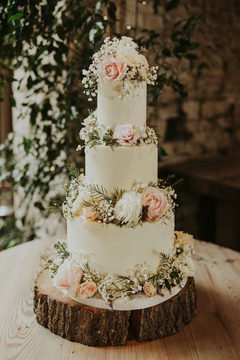 Three tier iced wedding cake decorated with fresh flowers. Images by Virginia Photography #weddingcake #cakedecoratingideas #cakedesigns #cakeideas #cakeinspiration