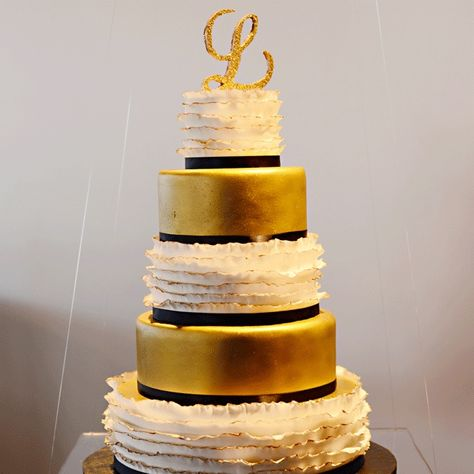 Gold, White, and Black Wedding Cake // Henry Photography // Enticing Icings and Custom Cakes Ltd. // http://www.theknot.com/weddings/album/a-formal-modern-wedding-in-columbus-oh-146657