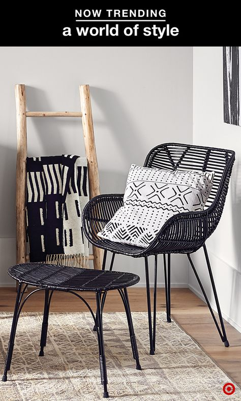 Create the perfect place to put your feet up with these sophisticated, travel-inspired pieces. Anchor the space with a black rattan chair and stool, and layer on black and white decor in a mix of complementary patterns. Stick to a simple color palette, adding pops of light wood and neutrals to keep the look feeling fresh and new.