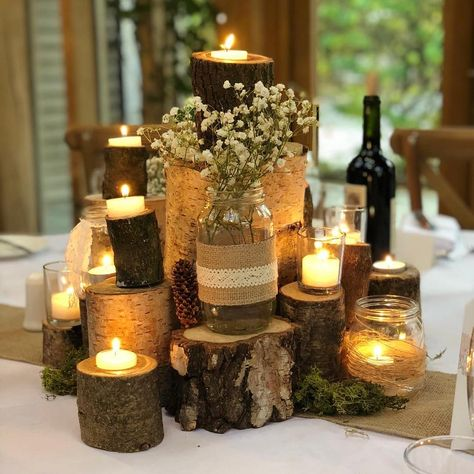 "Flossie's Weddings on Instagram: ""We just absolutely love this Table Centrepiece 😍😍😍 . . . #tablecentrepiece #rusticweddingdecor #rusticweddings #logs #candles #gypsophila…"""