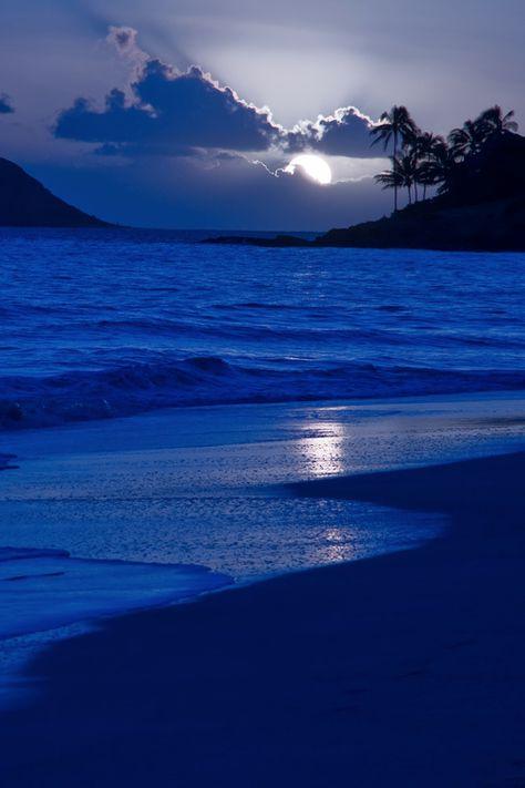 Blue Moon on a blue beach ocean