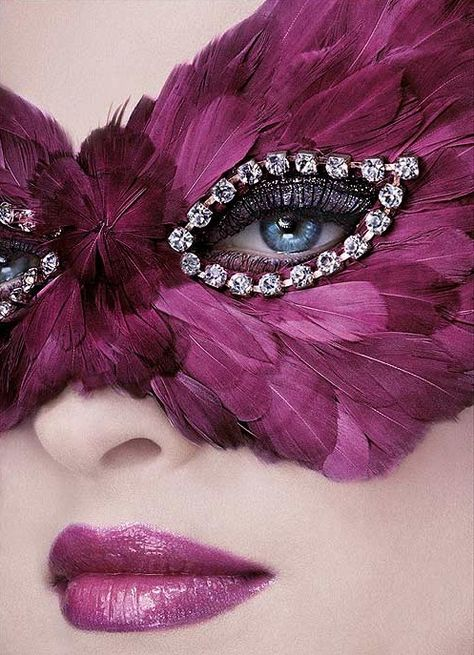 feather mask and diamond lined eyes