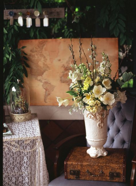 Vintage vases make perfect flower arrangements - especially if there's some sentimental attachment to the vases!    travel wedding inspiration | photo by Stacy Able | 100 Layer Cake