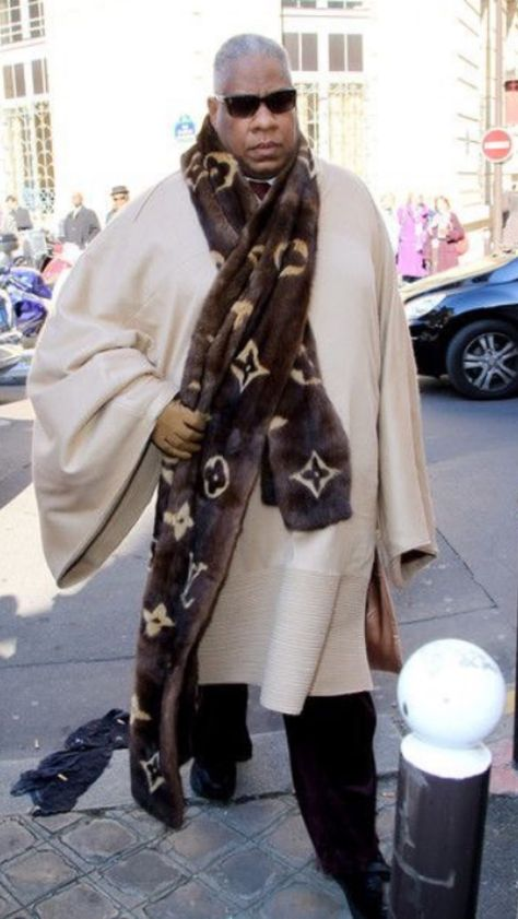 Andre Leon Talley, current contributing editor to American Vogue, overwhelmed by his enthusiasm for Louis in a 6 foot long, logo emblazoned mink scarf.