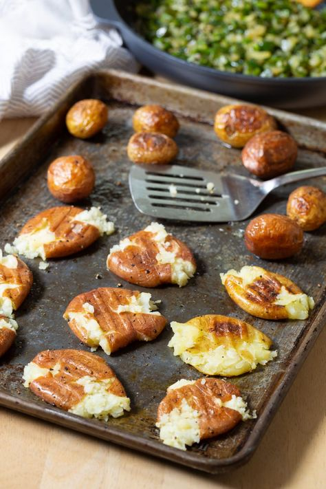 These little beauties are so irresistible, they make both a fabulous side dish and appetizer! #aspicyperspective #foodblog #foodie #instayum #hungry #thekitchn #onmytable #dailyfoodfeed #foodlove #foodpic #instafood #foodstagram #tasty #smashedpotato #smashedpotatoes #potatoes #beautifulcuisines #forkyeah #potatolove #roastedpotatoes #poblanopeppers #poblanos #peppers #quesofresco #queso #fresco #sidedish #appetizer #partyfood #partydish