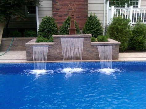 Complete Your Pool With A Stunning Waterfall Cambridge Pavers Waterfall Kits Are Easy To Install Pool Waterfall Water Features In The Garden Backyard Area