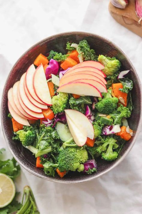 This vegan and gluten-free autumn salad is full of flavour and perfect as a cosy side dish! Made with kale and an abundance of other vegetables, and served with a delicious maple dressing. #vegansalad #autumnsalad #fallrecipes #butternutsquash #glutenfree