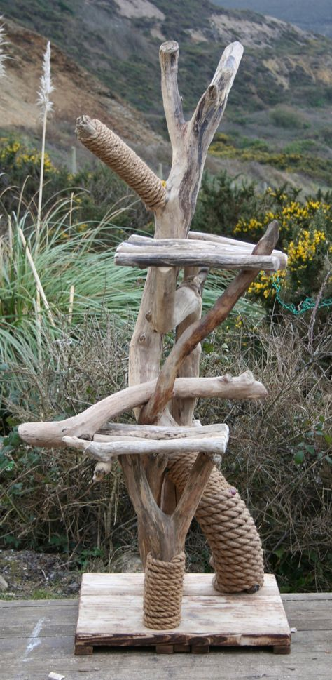 DIY cat tree inspiration: The thick rope wrapped around the bases of the tree branches is a neat idea