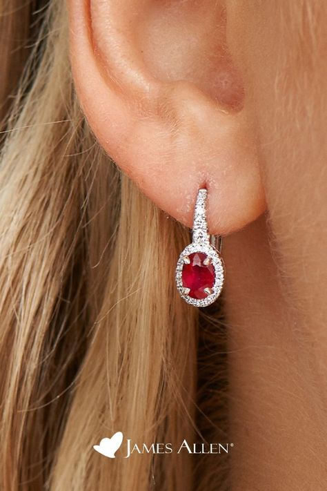 Celebrate a classic look with these petite drop earrings featuring oval rubies surrounded by a halos of glistening diamonds | James Allen Earring Style: 8323807W | #earrings #jewelry #jewellery #dropearrings #earringsoftheday #studs #accessories #fashionearrings #dangleearrings #gift #earringstyle #ruby #halo #jamesallen