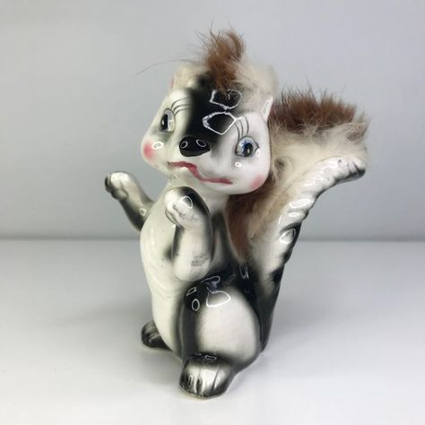 Vintage ceramic skunk with fur Japan
