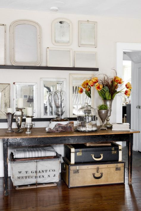 Joanna Madden  Console Table   Rikki Snyder Photography   Style Me Pretty Living   Home Tour   Vintage Mirrors   Suitcases