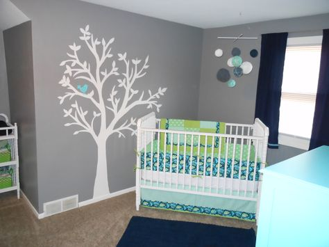 A gender neutral nursery design for those awaiting a special surprise...  {navy, aqua & apple green}
