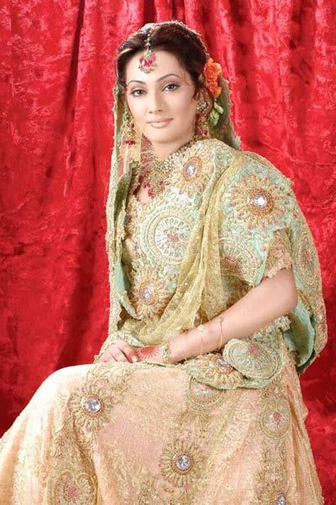 This is the image gallery of Pakistani Bridal Walima Dresses Collection 2014. You are currently viewing Pakistani Bridal Walima Dresses Collection 2014 (22). All other images from this gallery are given below. Give your comments in comments section about this. Also share stylehoster.com with your friends.    #walimadresses, #bridalwalimadresses, #bridaldresses, #pakistaniwedding