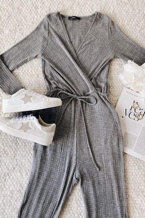 The perfect night-in consists of the Lulus All Is Cozy Heather Grey Long Sleeve Lounge Jumpsuit and a chunky, knit blanket! This ultra-soft lounge jumpsuit is the perfect piece to upgrade your sweatpants! #lovelulus